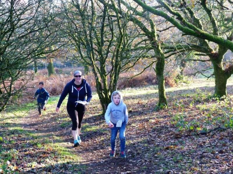A runner catching up walkers at Willett Hill