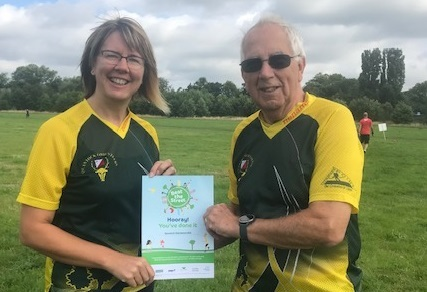 Roger and Vikki with the Certificate