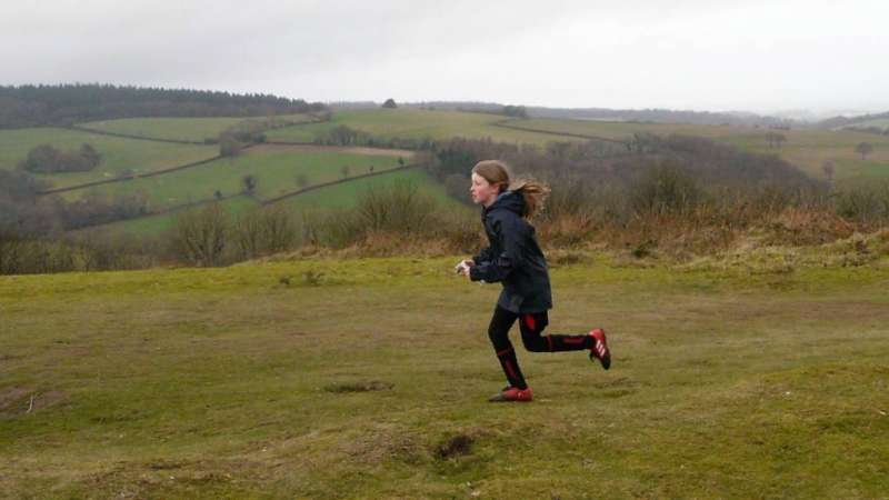 A junior focussed on her run and not the views, at Cothelstone Hill