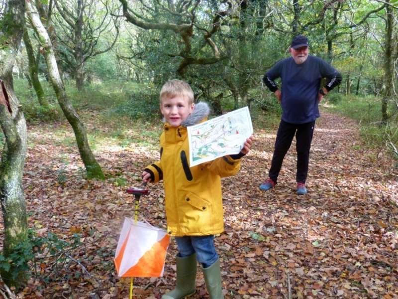 Mike with grandson and large-scale yellow map
