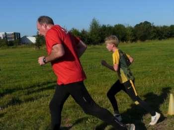 Jacob pushing a more senior runner