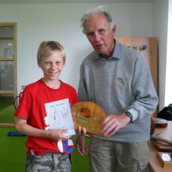 Ben Receives His Trophy For First Place On The Yellow Course