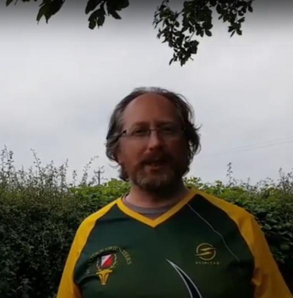 Alasdair presenting a club instructional video (with full lockdown hair)