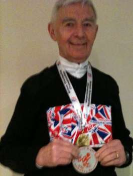 David Parkin, proudly displaying his medals