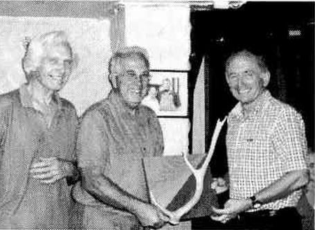 Ted (right) receiving the 2007 club champs trophy from current club president Roger C (centre) with Bill V on the left