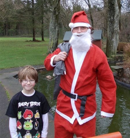 Father Christmas (Will K) & elf, head off into the woods at Blackborough 2012