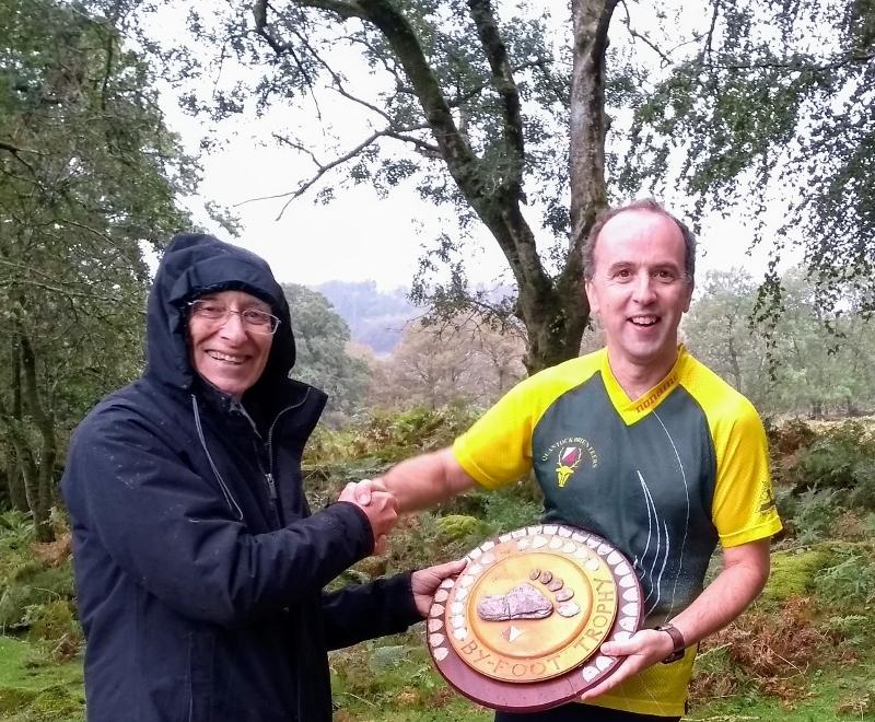 Richard S receives Devon's Byfoot Trophy on behalf of QO team