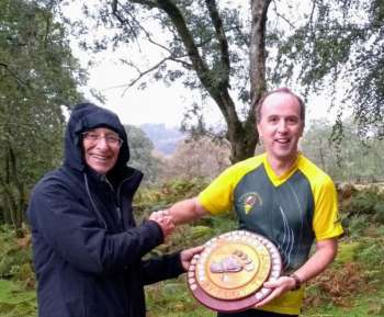 Richard S receives Devon's Byfoot Trophy on behalf of QO team